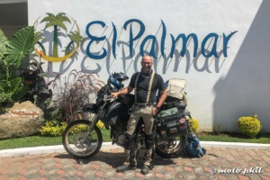 moto.phil in front of his DR650SE and the El Palmar sign