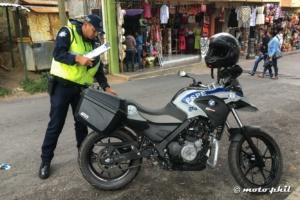 Policeman putting stuff in his BMW 650 GS