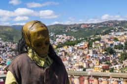 Skull statue in front of Guanajuato view
