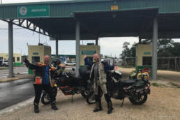 Shawn Cousins and moto.phil at the border between Mexico and Belize