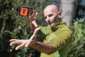 moto.phil levitating the SPOT GPS Messenger