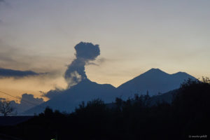 The silhouettes of the two sister volcanoes Volcán de Fuego and Acatenanco at sunset