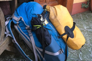 Blue backpack with yellow drybag on top