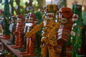 Colorful handcrafted statues in Antigua local market