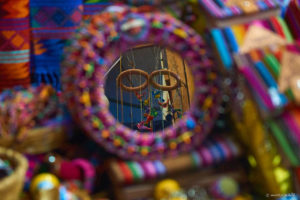 """Local market for tourists carry colorful """"artesanal"""" products, made in china."""