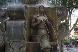 Fountain in main square in Antigua, a woman holding her water giving breasts