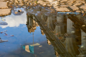 Reflection of guatemalan flag and colonial building in Antigua