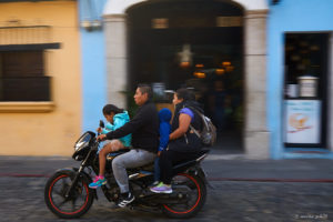 Family on small motorcycle in Antigua