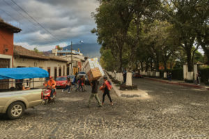 Man in Antigua Guatemala carrying a big load