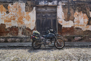 DR650 in front of old wall in Antigua