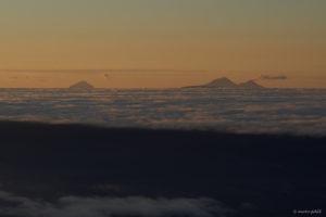 Sunrise view from Unicornio Azul with Volcan de Fuego smoking