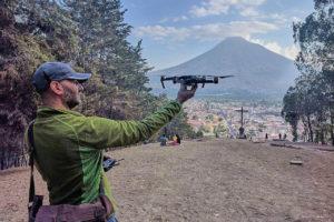 moto.phil holding DJI Mavic Pro in front of Antigua and Volcano Agua