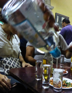 "Pouring of mexican Tequila in ""La Fuente"" a classic mexican Cantina in Guadalajara"