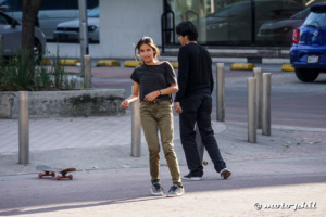Young skater girl jumping off her skateboard in Guadalajara