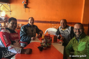 moto.phil with three motorcycle riders in a small restaurant in Mexico