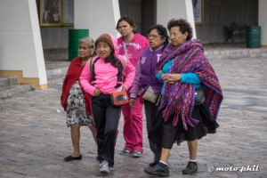 Mexican ladies with colorful dresses at Cristo Rey