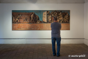 Man standing in front of a painting in san miguel de allende