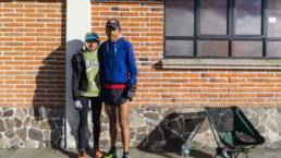 Runners in front of a brick wall at Iztaccihuatl & Popocatepetl National Park
