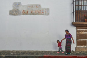 Mayan woman in traditional clothing with her kid