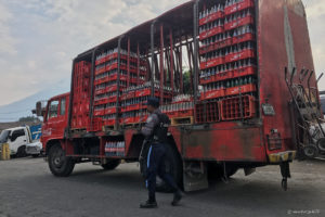 Armed guard in front of Coca Cola Truck in Antigua
