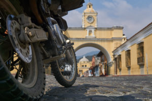 DR650 in front of Santa Catalina Arch and iglesia de la Merced in the background.
