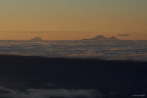 Sunrise view from Unicornio Azul with Volcan de Fuego smoking