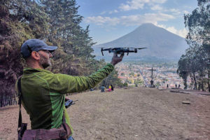 moto.phil holding DJI Mavic Pro in front of Antigua and Volcano Agua